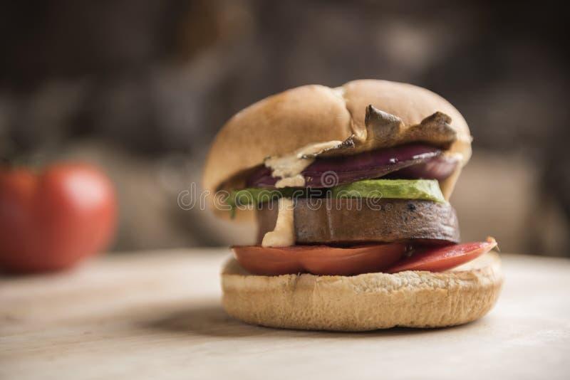 Vegan burger with vegetable tofu patty royalty free stock images