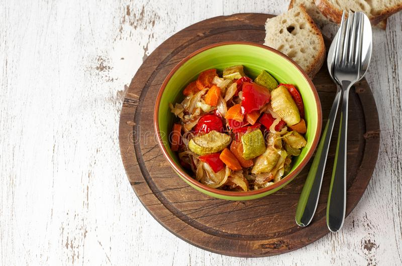 Vegan cabbage, carrot, paprika and zucchini stew royalty free stock photography