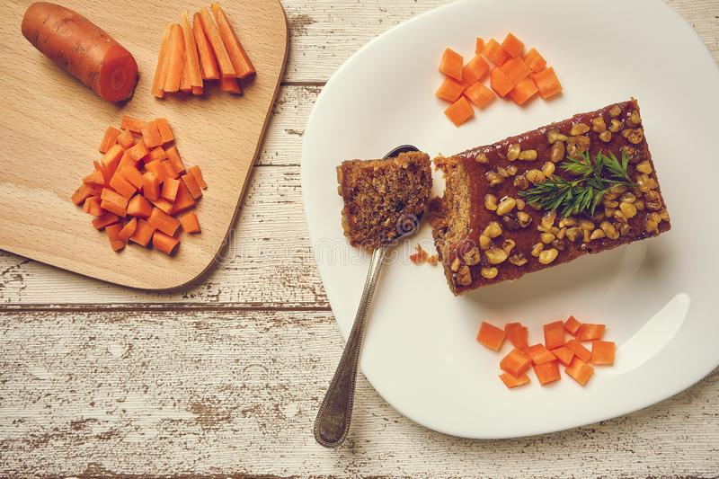 Vegan carrot cake with walnuts stock images