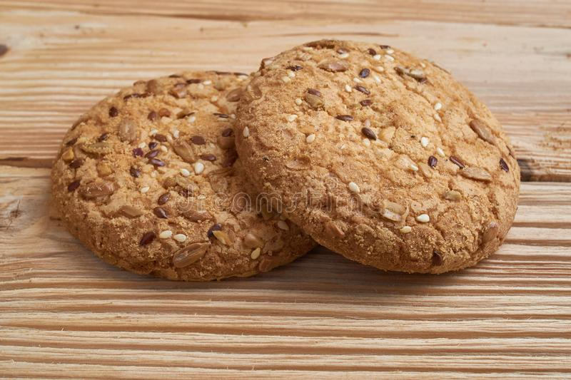 Vegan crunchy cookies with sunflower, flax seeds and sesame seeds . Macro view royalty free stock photo