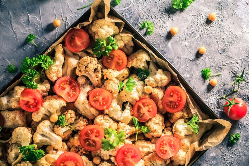 Vegan dish cauliflower baked chickpeas tomatoes stock images