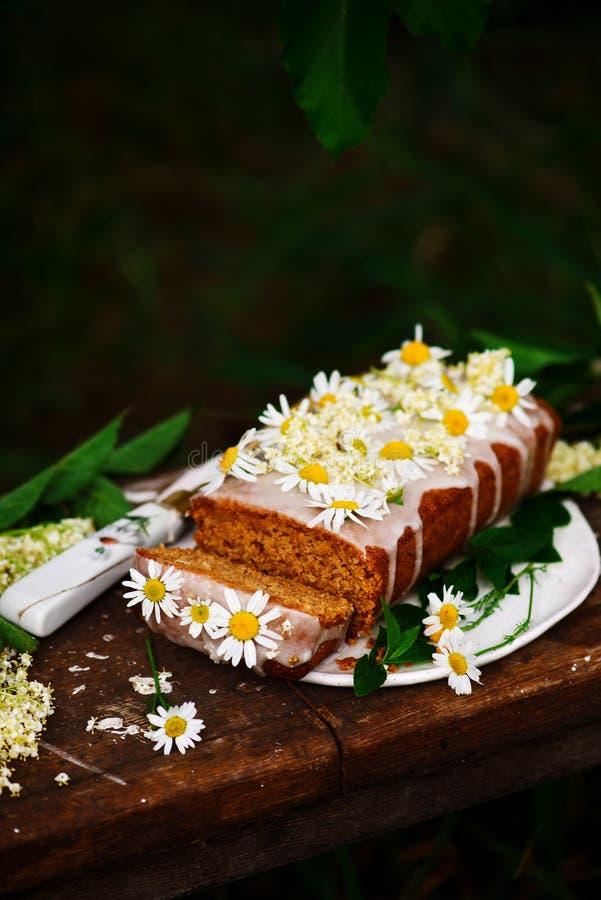 Vegan elderflower honey lemon drizzle cake. stock image