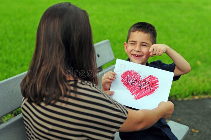 Vegan family lifestyle with child royalty free stock photos