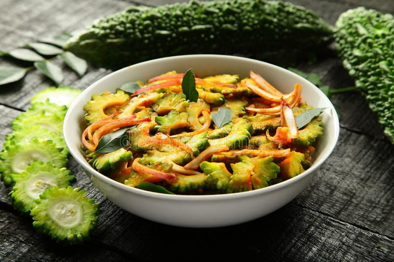 Vegan food Stir fry bitter gourd from Indian cuisine. Homemade spicy fried bitter gourd served in bowl.Indian cuisine.selective focus royalty free stock photos