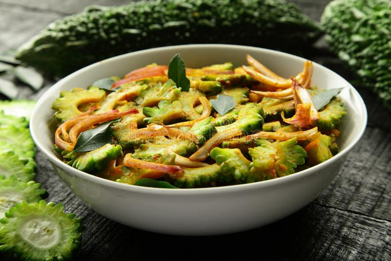 Vegan food Stir fry bitter gourd from Indian cuisine. Homemade spicy fried bitter gourd served in bowl. Indian cuisine. selective focus royalty free stock photography