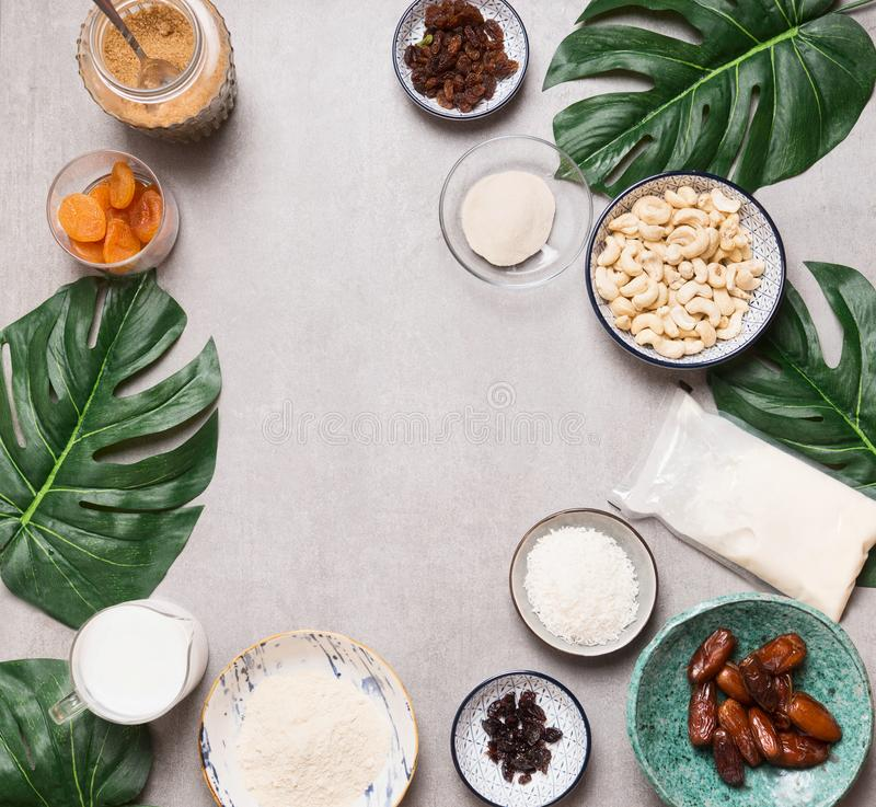 Vegan gluten-free cake ingredients: cashew , non dairy milk, almond flour, Coconut cream and milk, agar agar and dried fruits . Top view. Flat lay. Frame stock images