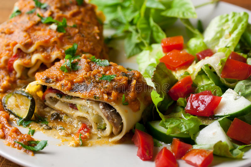 Vegan Lasagna Rolls. With a healthy side salad stock photography