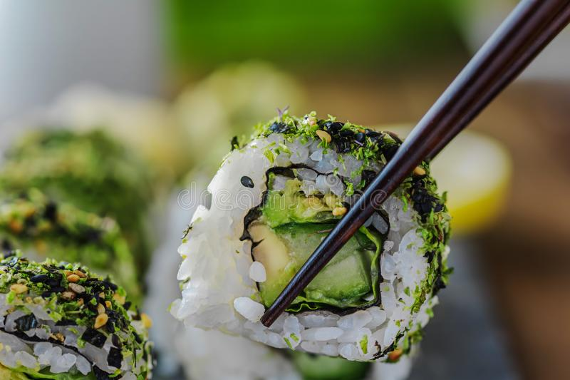 Vegan maki with avogado and herbs royalty free stock image