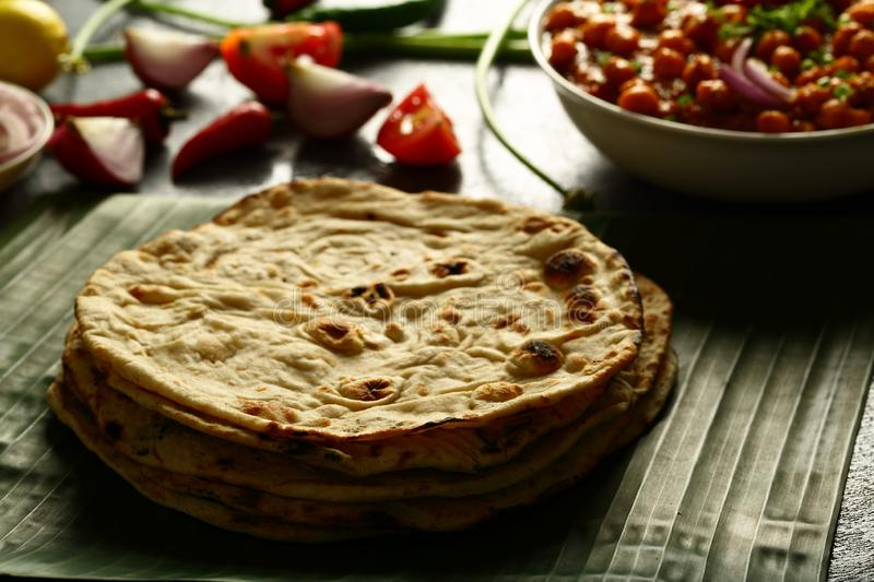 Vegan meal- tandoori roti served with chickpea curry. Healthy vegan diet food- homemade roti served with chickpea curry channa masala. whole wheat flat bread stock image