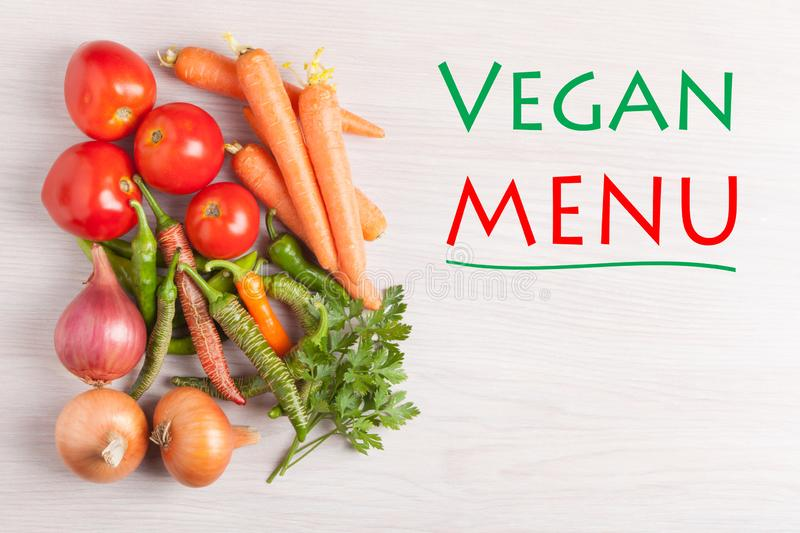 Vegan Menu Concept. Vegan Menu text and group vegetables. Diet, healthy and lifestyle concept royalty free stock photos