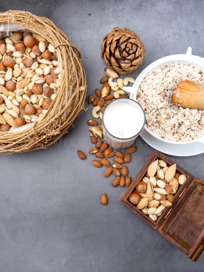 Vegan milk from nuts in glass with various nuts. Organic healthy snack vegan vegetarian royalty free stock photography