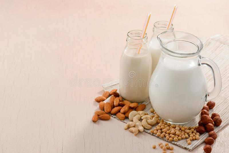 Vegan milk and various ingredients stock images