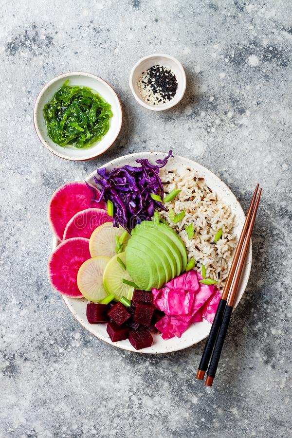 Free Vegan Poke Bowl With Avocado, Beet, Pickled Cabbage, Radishes. Top View, Overhead, Flat Lay. Stock Images - 116735214