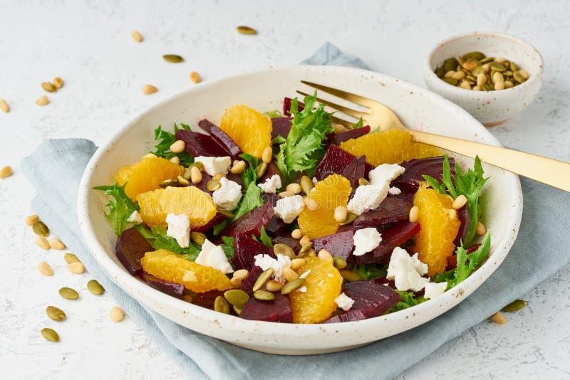 Vegan salad with beet curd avocado orange feta ricotta and pumpkin seeds, keto ketogenic dash diet, closeup, pastel modern. Salad with beet, curd, avocado royalty free stock photos