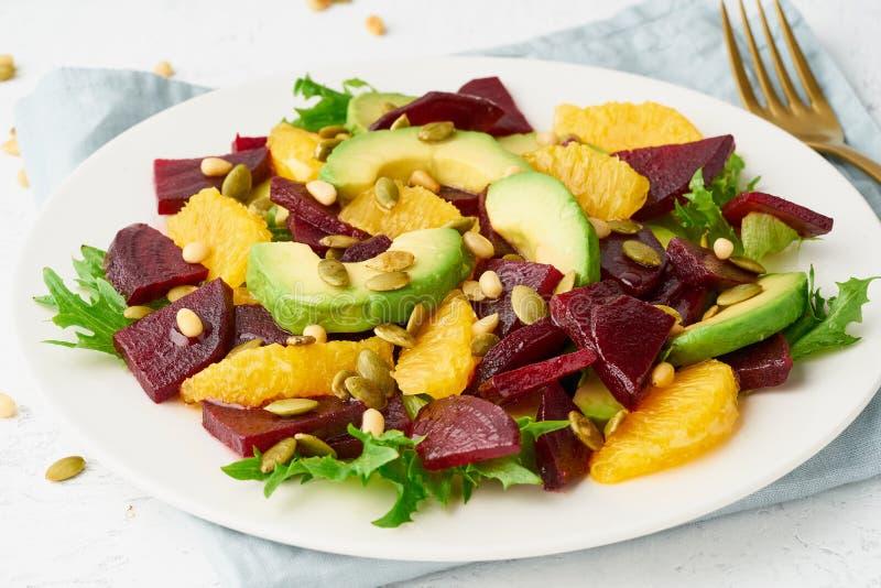 Vegan salad with beet curd avocado orange feta ricotta and pumpkin seeds, keto ketogenic dash diet, closeup, pastel modern. Salad with beet, curd, avocado stock photos