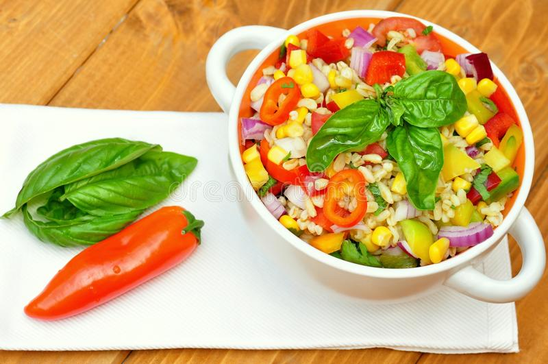 Vegan salad with kamut and fresh , raw veggies. Khorasan wheat is an ancient grain type that can be found in products such as breads, breakfast cereals, pastas stock photography