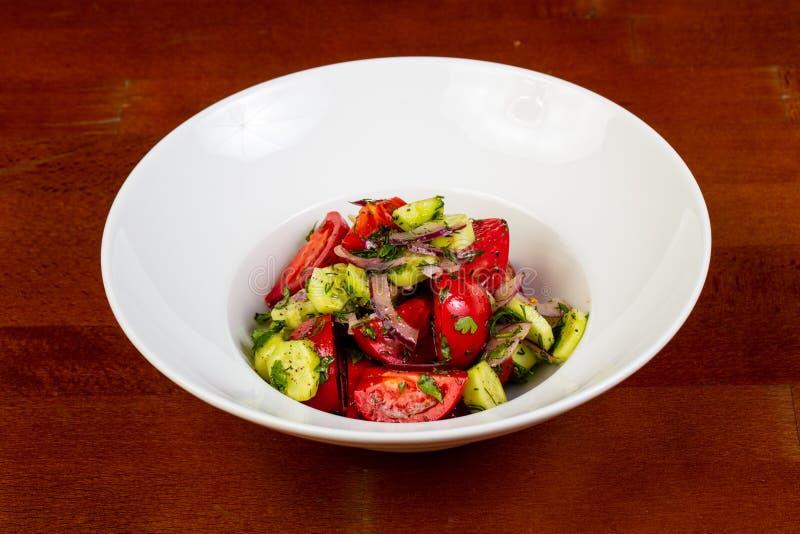 Vegan salad with tomato royalty free stock photography