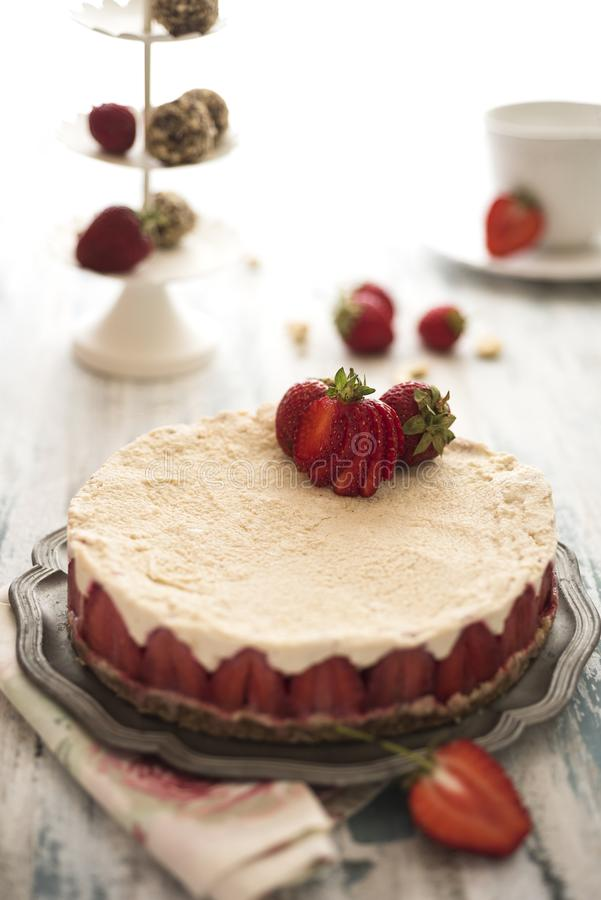 Vegan strawberry cheesecake with fresh fruits royalty free stock photos