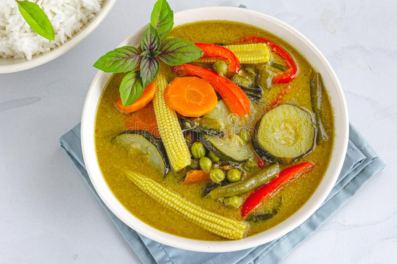 Vegan Thai Green Curry with Rice, Garnished with Thai Basil. Directly Above Photo. Traditional Thai Food Photography royalty free stock images