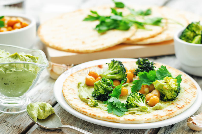 Vegan tortilla with roasted broccoli and chickpeas and avocado s royalty free stock photo
