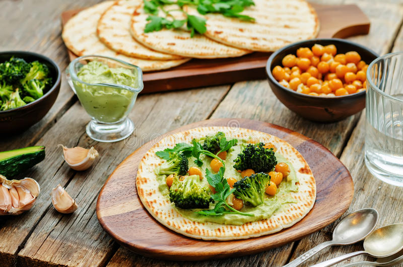 Vegan tortilla with roasted broccoli and chickpeas and avocado s stock images