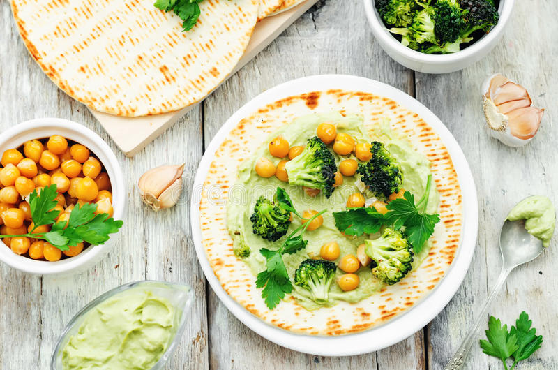 Vegan tortilla with roasted broccoli and chickpeas and avocado s stock image