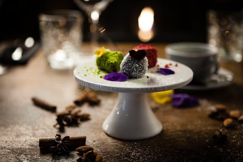 Vegan truffles dessert served on a plate in restaurant royalty free stock image