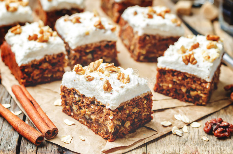 Vegan walnuts carrot cake with cashew cream frosting stock photo