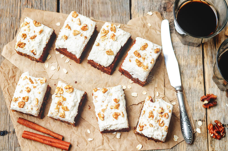 Vegan walnuts carrot cake with cashew cream frosting royalty free stock photography