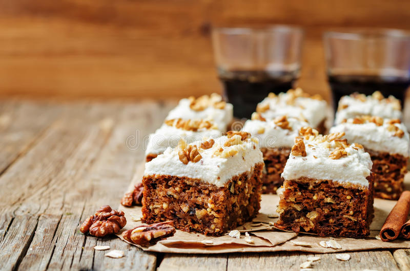 Vegan walnuts carrot cake with cashew cream frosting stock image