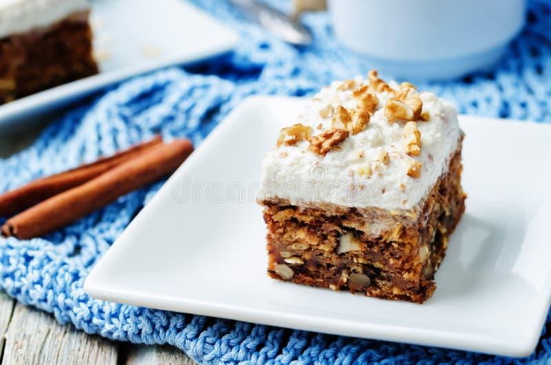 Vegan walnuts carrot cake with cashew cream frosting stock photos
