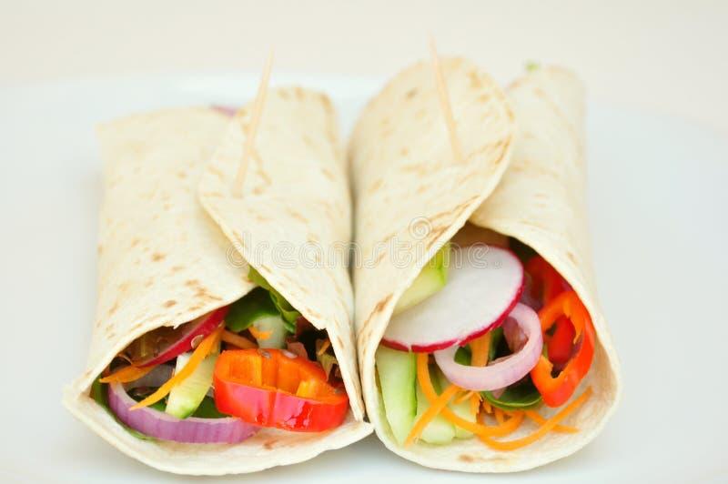 Vegan wraps with fresh, raw vegetables royalty free stock photo