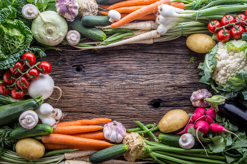 Vegetable. Assortment of fresh vegetable on rustic old oak table. Vegetable from market place stock photo