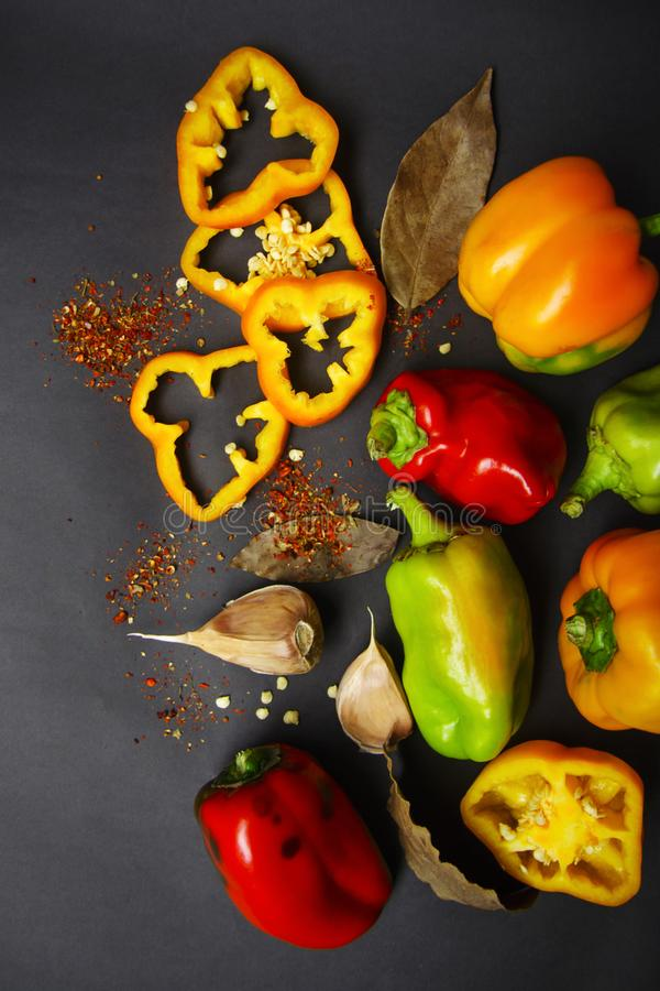 Vegetable assortment - sweet pepper and garlic on a gray background royalty free stock photo