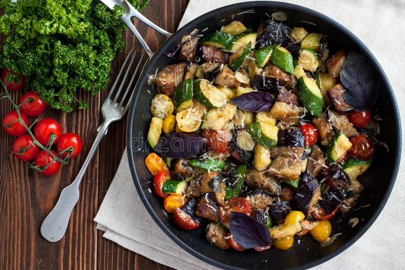 Vegetable bake from zucchini, eggplants, cherry tomatoes royalty free stock images