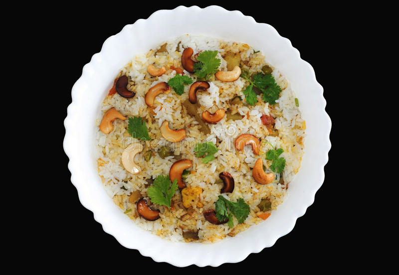 Vegetable biryani in white plate stock photography