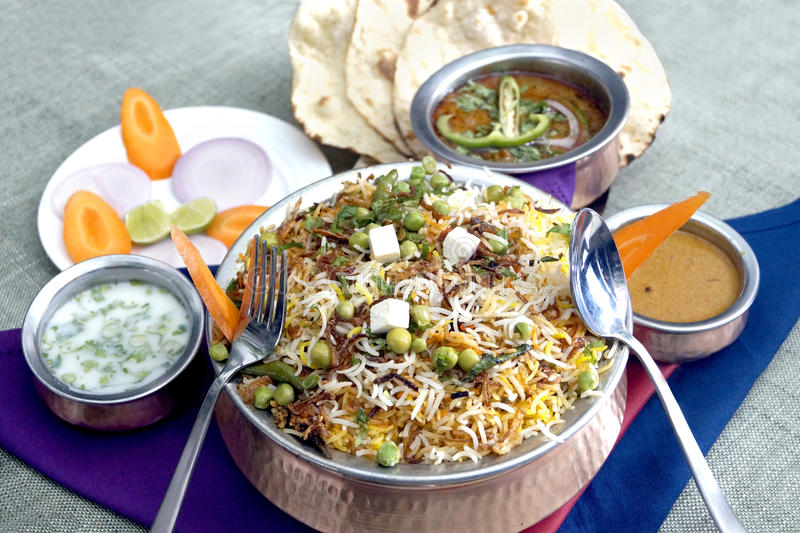 Vegetable biryani, eggplant curry,tandoori roti, stock images