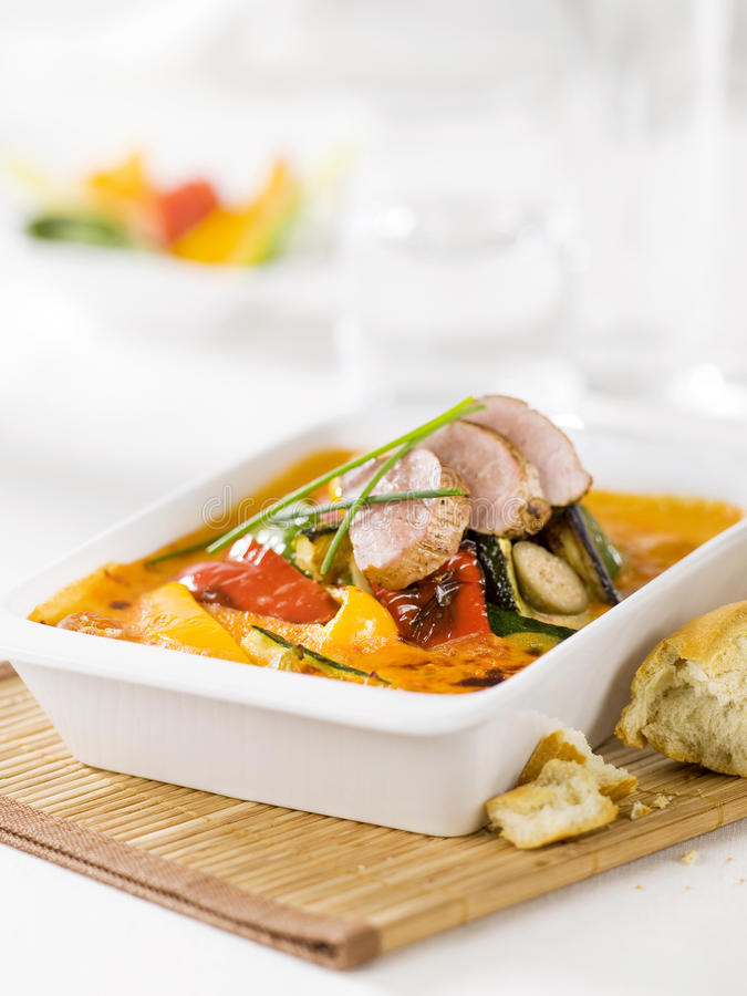 Vegetable casserole and smoked meat royalty free stock photography
