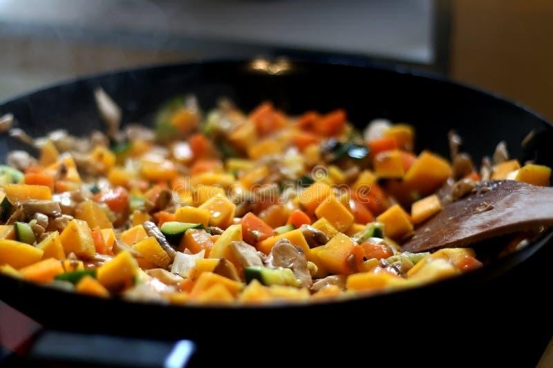 Stir Fry. Vegetable and champignon mushroom stir fry in wok. Selective focus stock photos
