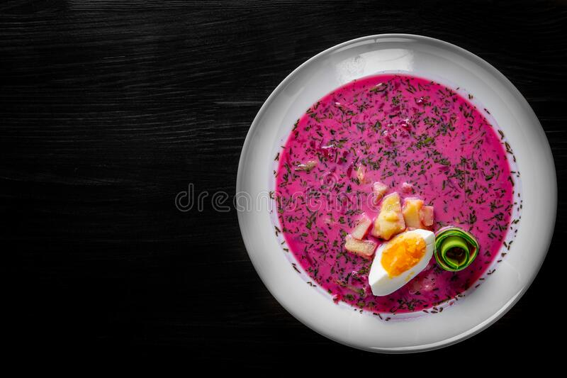 Vegetable cold soup with beet, cucumber, radsih and egg royalty free stock images