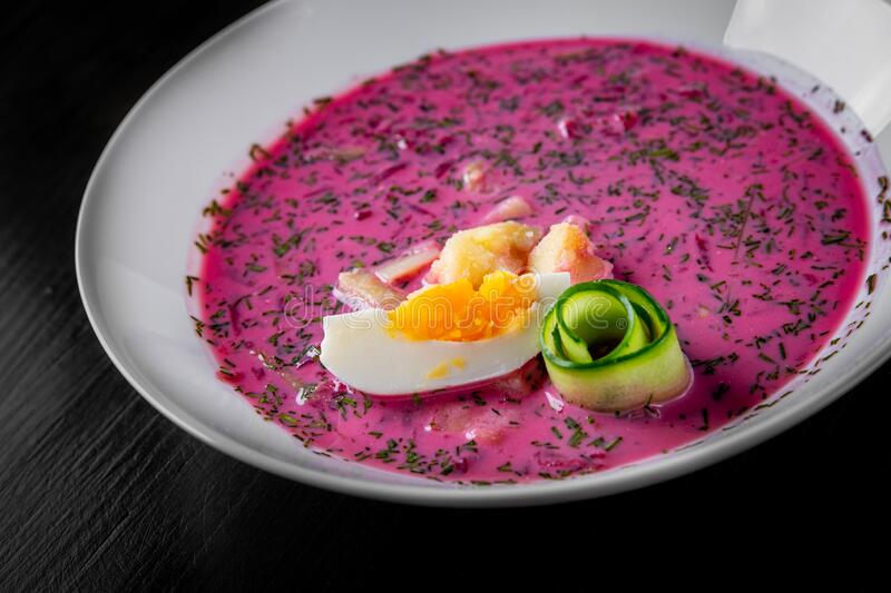 Vegetable cold soup with beet, cucumber, radsih and egg stock photos