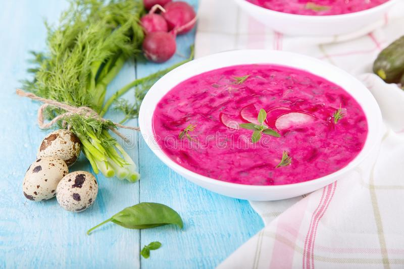 Vegetable cold soup with beetroots and natural yoghurt. Cold borscht - helpful for hot days. Ingredients cold soup: quail eggs, green onion, cucumber, dill stock photos