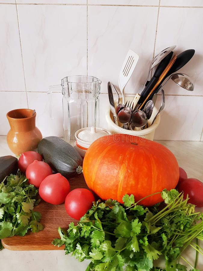 Vegetable composition in the kitchen. Pumpkin and zucchini. Before preparing dinner. royalty free stock photography