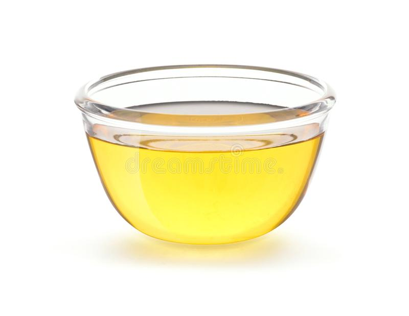 Vegetable Cooking Oil in glass bowl. Isolated on white background with clipping path stock photo