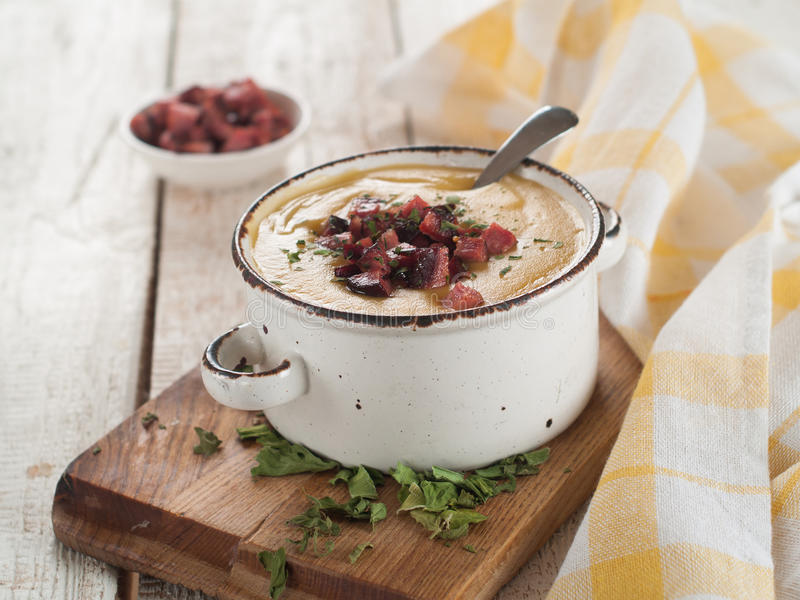 Vegetable cream soup. Vegetable or peas cream soup with chorizo, selective focus royalty free stock image