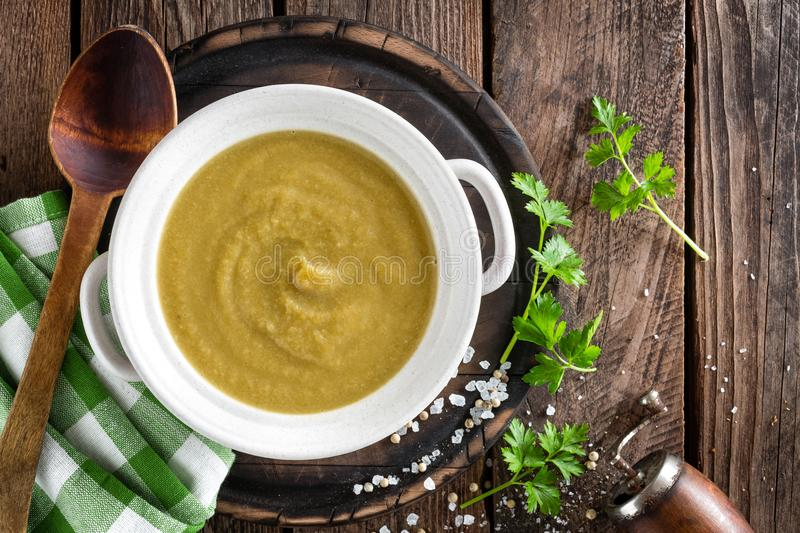 Vegetable cream soup, puree on wooden rustic table. Top view stock photos