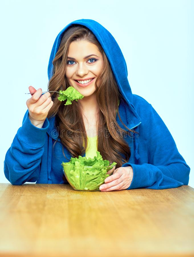 Vegetable diet concept. woman eating salad. Smiling female model royalty free stock photography