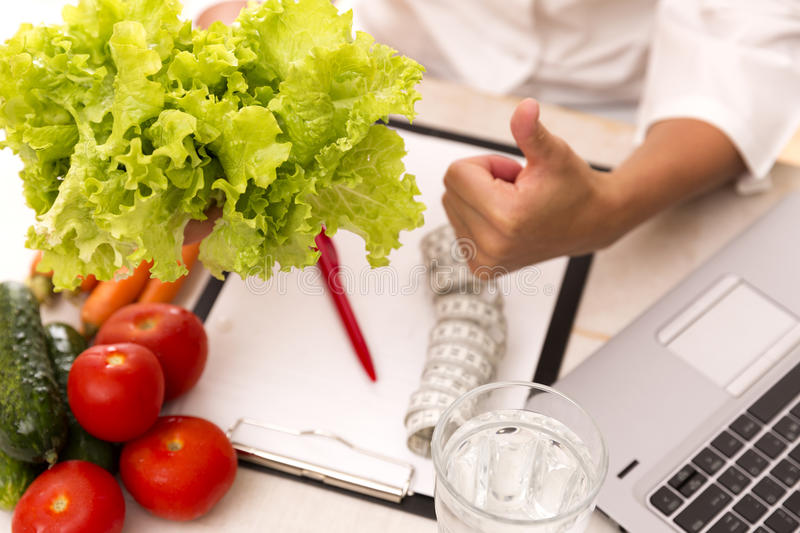 Vegetable diet nutrition and medication concept. Nutritionist offers healthy vegetables diet. royalty free stock photography