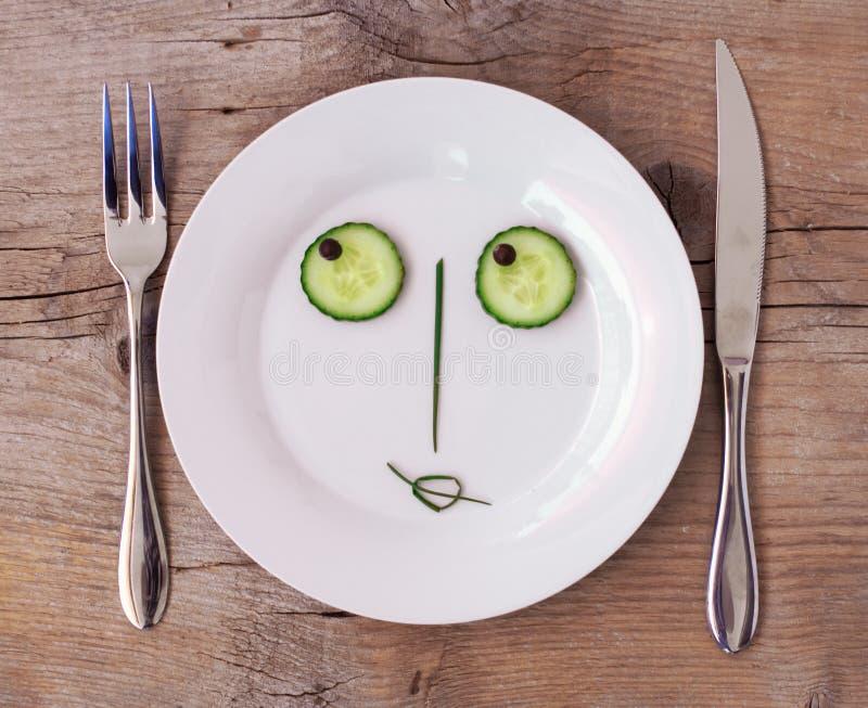Vegetable Face on Plate - Female, Flirting stock image