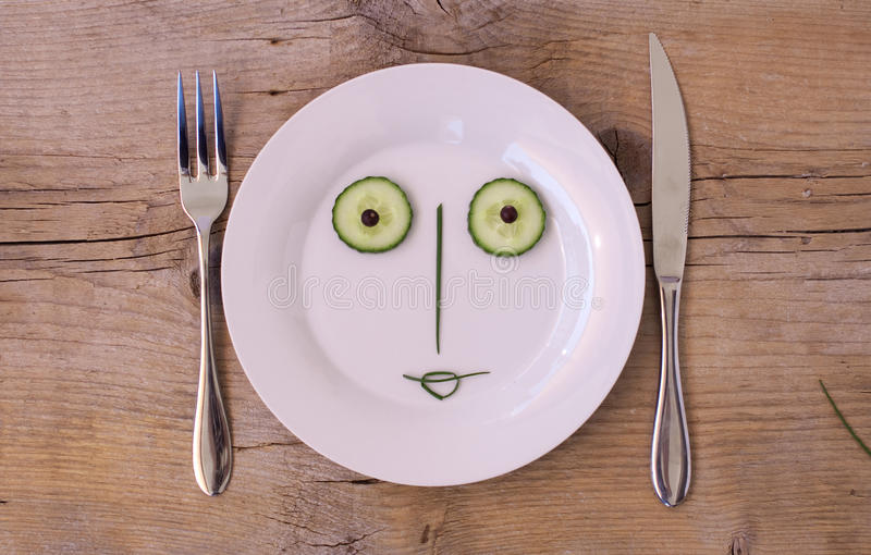 Vegetable Face on Plate - Female, Happy royalty free stock photos